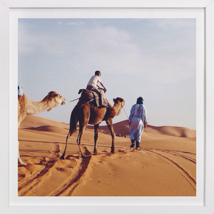A boy and his camel Art Print