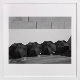 Four Black Umbrellas Art Print